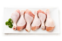 Fresh raw chicken drumsticks. Group of fresh raw chicken legs on white background Royalty Free Stock Photo