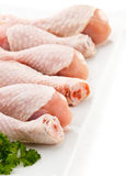 Fresh raw chicken drumsticks. Group of fresh raw chicken legs on white background Royalty Free Stock Photos