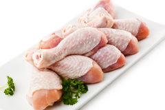 Fresh raw chicken drumsticks. Group of fresh raw chicken legs on white background Royalty Free Stock Images