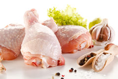 Fresh raw chicken drumsticks. Group of fresh raw chicken legs on white background Stock Images