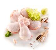 Fresh raw chicken drumsticks. Group of fresh raw chicken legs on white background Stock Image