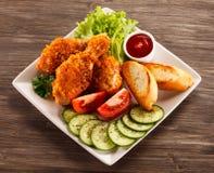 Fresh raw chicken drumsticks. Group of fresh raw chicken drumsticks on wooden background Stock Images