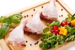 Fresh raw chicken drumsticks. On white background Royalty Free Stock Photos