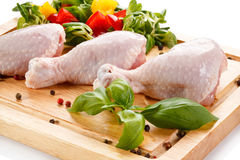 Fresh raw chicken drumsticks. On white background Royalty Free Stock Photography