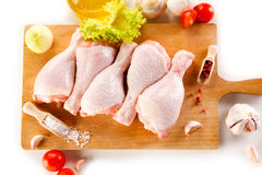 Fresh raw chicken drumsticks. On white background Royalty Free Stock Photo