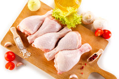 Fresh raw chicken drumsticks. On white background Royalty Free Stock Images