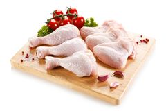 Fresh raw chicken drumsticks and wings. On white background Stock Photos