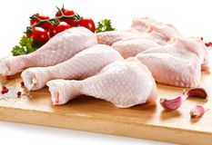 Fresh raw chicken drumsticks and wings. On white background Royalty Free Stock Photo