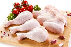 Fresh raw chicken drumsticks and wings. On white background Stock Image
