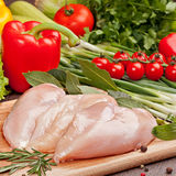Fresh raw chicken  fillet  and vegetables. Prepared for cooking Royalty Free Stock Photos