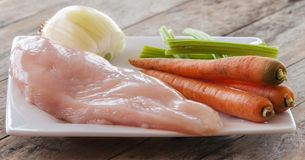 Fresh raw chicken fillet. And vegetables prepared for cooking Stock Image