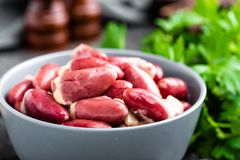 Fresh raw chicken hearts. On dark background Royalty Free Stock Photos