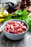 Fresh raw chicken hearts. On dark background Stock Image