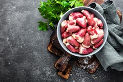 Fresh raw chicken hearts on dark background, top view. Fresh raw chicken hearts on dark background Stock Photo