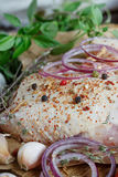 Fresh raw chicken with herbs, garlic, onion, tomatoes and chilli. Pepper. Close up Stock Photos