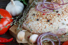 Fresh raw chicken with herbs, garlic, onion, tomatoes and chilli Stock Photos