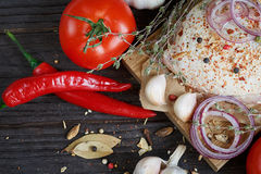 Fresh raw chicken with herbs, garlic, onion, tomatoes and chilli. Pepper. Close up Stock Images