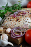 Fresh raw chicken with herbs, garlic, onion, tomatoes and chilli. Pepper. Close up Royalty Free Stock Images