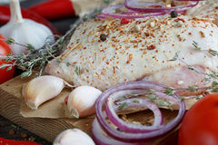Fresh raw chicken with herbs, garlic, onion, tomatoes and chilli. Pepper. Close up Royalty Free Stock Photos