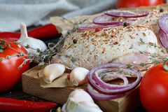 Fresh raw chicken with herbs, garlic, onion, tomatoes and chilli Stock Photo