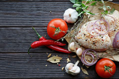 Fresh raw chicken with herbs, garlic, onion, tomatoes and chilli Royalty Free Stock Photography