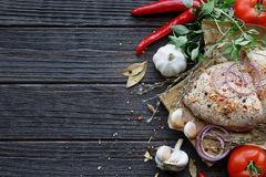 Fresh raw chicken with herbs, garlic, onion, tomatoes and chilli Royalty Free Stock Image