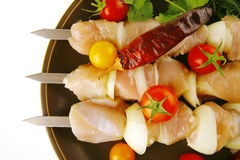 Fresh raw chicken kebabs on plate Royalty Free Stock Images