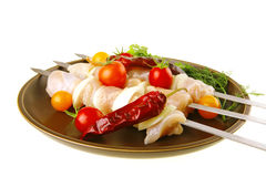 Fresh raw chicken kebabs on plate Stock Image
