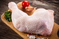 Fresh raw chicken leg. On wooden background Stock Images