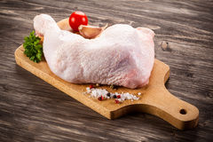 Fresh raw chicken leg. On wooden background Stock Photo
