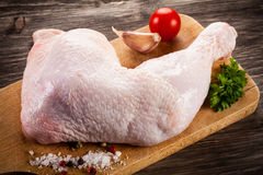 Fresh raw chicken leg. On wooden background Royalty Free Stock Image