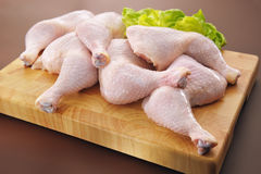 Fresh raw chicken legs. Arrangement on kitchen cutting board Royalty Free Stock Image
