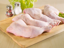 Fresh raw chicken legs arrangement. On kitchen cutting board Stock Photography