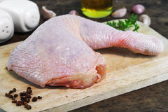 Fresh raw chicken legs. Arrangement on kitchen cutting board Royalty Free Stock Photos