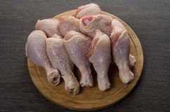 Fresh raw chicken legs arrangement on kitchen cutting board. Fresh raw chicken legs arrangement on a kitchen cutting board Royalty Free Stock Photos