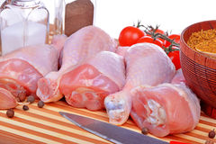 Fresh raw chicken legs. On cutting board Royalty Free Stock Images
