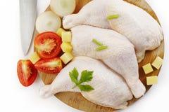 Fresh raw chicken legs. On cutting board Stock Photo