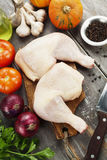 Fresh raw chicken legs. On the cutting board Stock Images