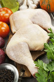 Fresh raw chicken legs. On the cutting board Royalty Free Stock Image