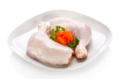 Fresh raw chicken legs. Group of fresh raw chicken legs on white background Stock Photography