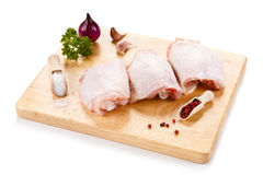 Fresh raw chicken legs. Group of fresh raw chicken legs on white background Stock Photos
