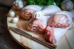 Fresh raw chicken legs  on kitchen cutting board with dill and g. Fresh Raw Chicken Legs On Kitchen Cutting Board With Dill And Garlic Royalty Free Stock Photos