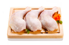 Fresh raw chicken legs. On white background Royalty Free Stock Photo