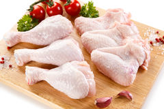 Fresh raw chicken legs and wings. Group of fresh raw chicken legs and wings on white background Stock Photo
