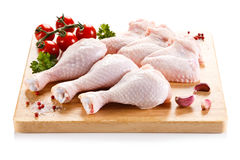 Fresh raw chicken legs and wings. Group of fresh raw chicken legs and wings on white background Stock Image