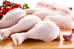 Fresh raw chicken legs and wings. Group of fresh raw chicken legs and wings on white background Royalty Free Stock Photo
