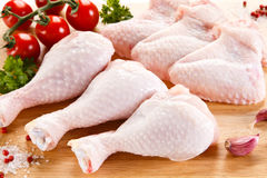 Fresh raw chicken legs and wings. Group of fresh raw chicken legs and wings on white background Stock Photography