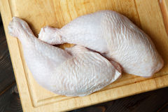 Fresh raw chicken legs on wooden board Royalty Free Stock Photography
