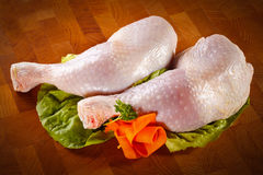 Fresh raw chicken legs. On wooden desk Royalty Free Stock Photo