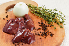 Fresh raw chicken liver. With spices on cutting board. Cooking food Stock Photos